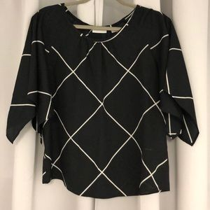 Black & white Flowing sleeve blouse. Never worn